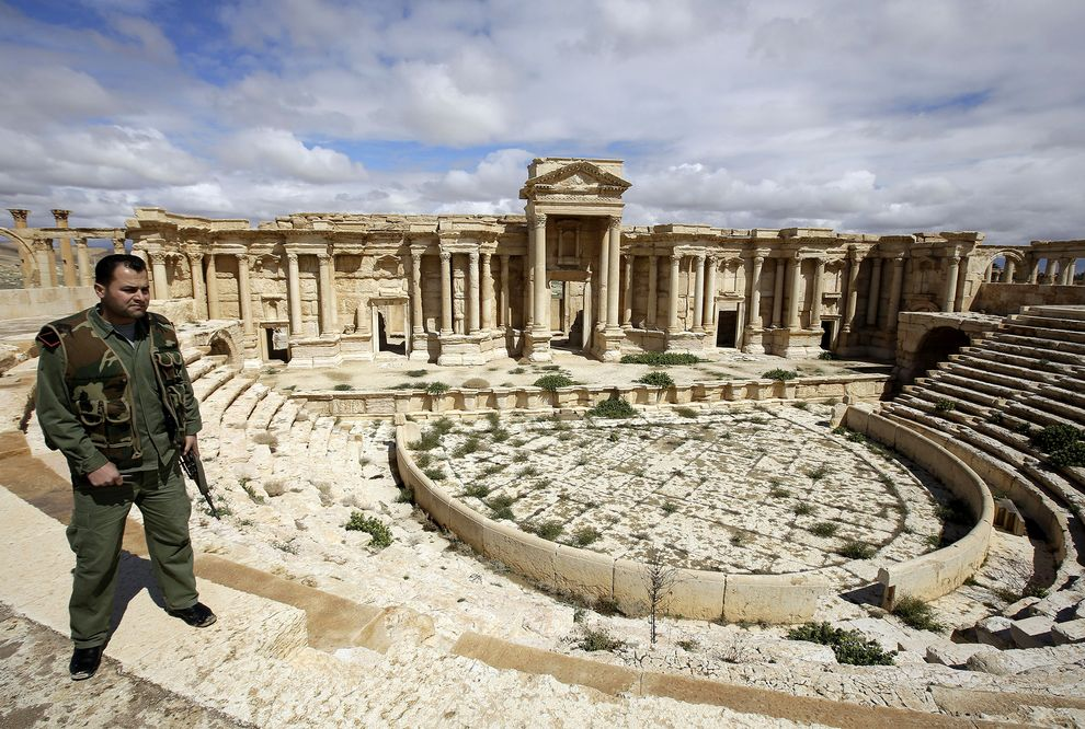 A Syrian policeman patrols the ancient city of Palmyra. PHOTOGRAPH BY JOSEPH EID/AFP/GETTY IMAGES